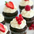 Red berry cupcakes — Stock Photo #3707734