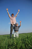 Father and son hands up — Stock Photo