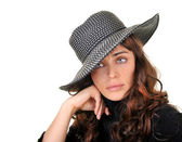 Beautiful woman in a hat isolated on white. — Stock Photo