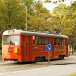 Red tram on street — Stock Photo #2769084