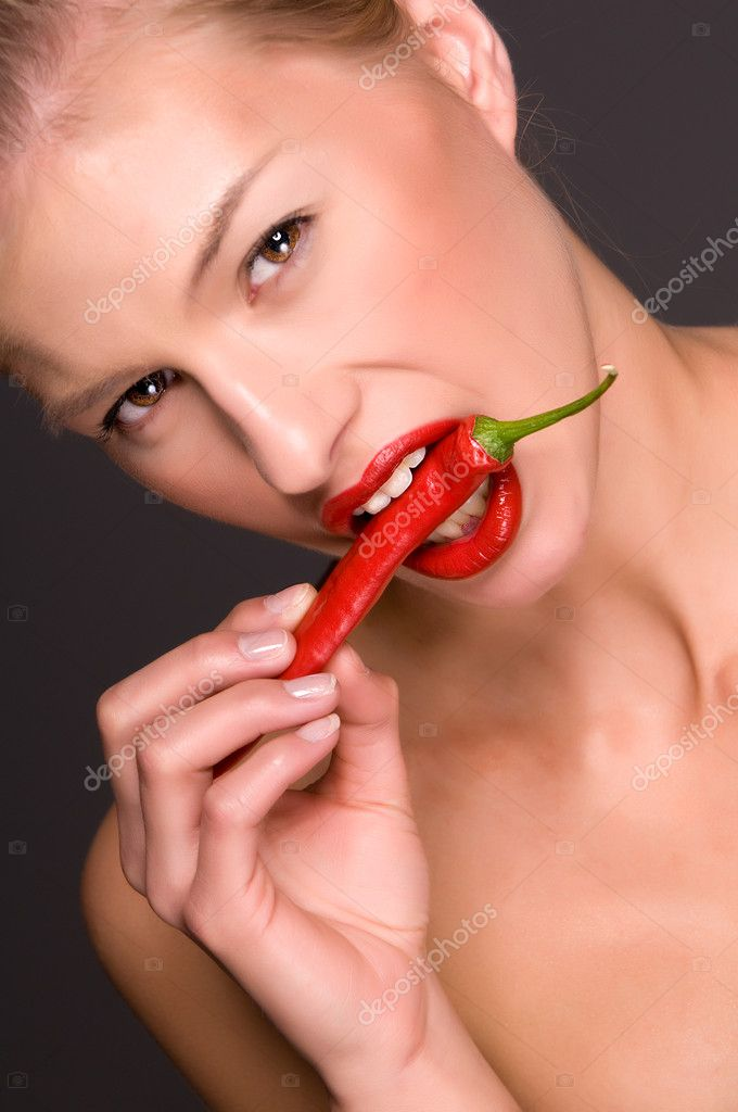 Fashion model holding a red hot chili fruit  Stock Photo #2791586