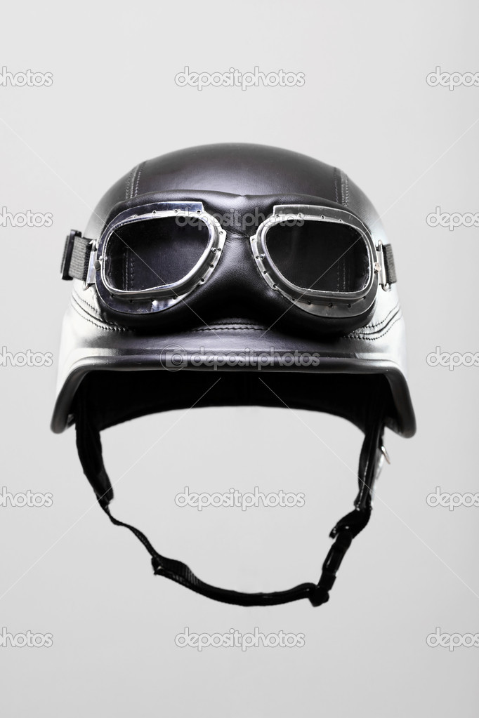 Old-style us army motorcycle helmet with goggles, on gray background  Stock Photo #3030552