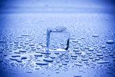 Cubos de hielo y gotas de agua — Foto de Stock