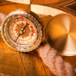 Old compass and rope - Stock Photo