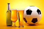 Chilled beer and football concept — Stock Photo