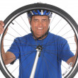 Stock Photo: Cyclist looking thru Wheel