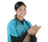 женский медицинский работник, писать на борту клип — Стоковое фото