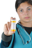 Female medical professional with Prescription Bottle — Stock Photo