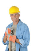 Worker holding onto shovel handle — Stock Photo