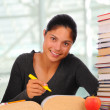 Stock Photo: Smiling Female Student with Books