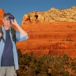 Hiker with Binoculars in Sedona - Stock Photo