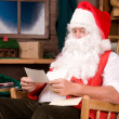 Royalty-Free Stock Photo: Santa Claus in Workshop With Letters