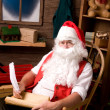 Santa Claus in Workshop With List — Stock Photo