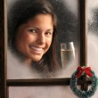 Woman in window with champagne — Stock Photo