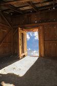Wood shack with sky through door — Stock Photo