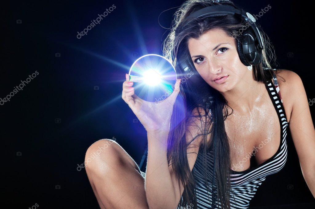 Hot beautiful girl like a dj and black background  — Stock Photo #3845427