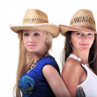 Two Girls Wearing cowboy Hats And Smiling Isolated On A White — Stock Photo