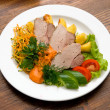 Meat dish with fresh vegetables - Stock Photo