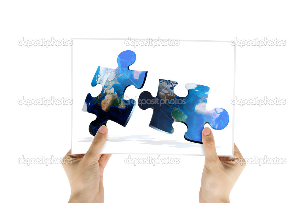 Hand hold photo of global map puzzles communication on white background  Stock Photo #2744977