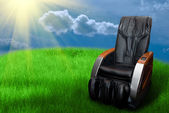 Massage arm-chair on the grass field — Stock Photo
