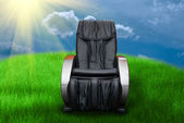 Sunny day with massage arm-chair — Stock Photo