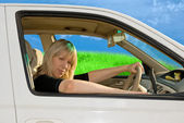 Young woman driving — Stock Photo