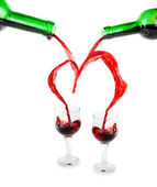 Heart from pouring red wine — Stock Photo