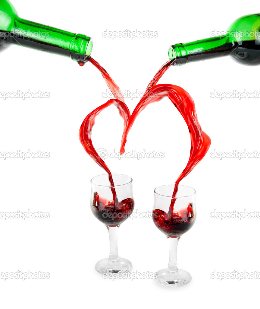 Heart from pouring red wine in goblet isolated on white — Stock Photo #2757549