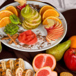 Set of sweet fruit and cake - Stock Photo