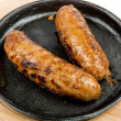 Fried sausages - Stock Photo