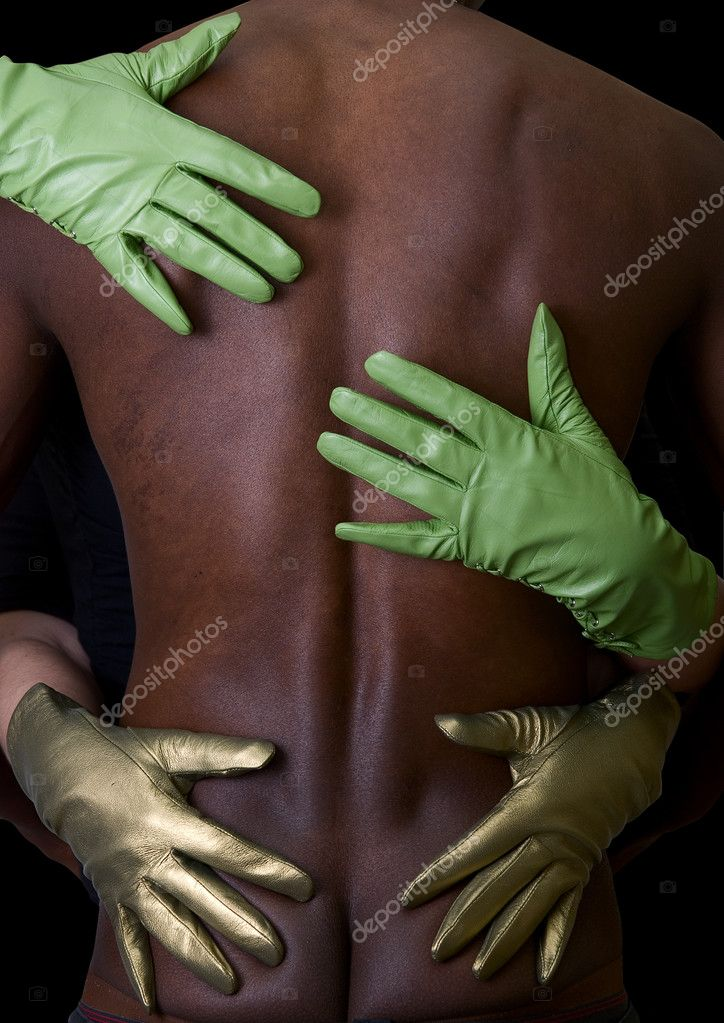 Two girl hands embrace black man at gloves on white  Stock Photo #2760603