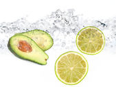 Limes in water avocado — Stock Photo