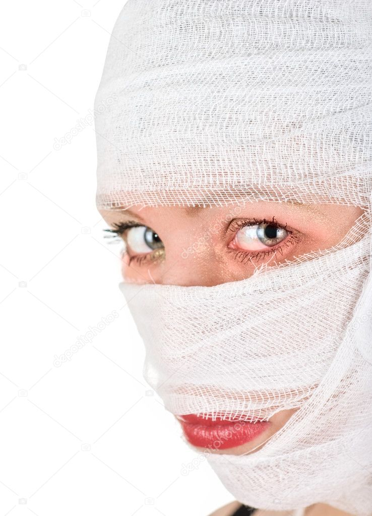 Woman with bandages on her face on white — Stock Photo #3096351
