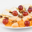 Cheese and grapes and nuts — Stock Photo #3140932