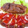 Stock Photo: Beef steak with pomegranate