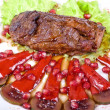 Beef steak with pomegranate — Stock Photo