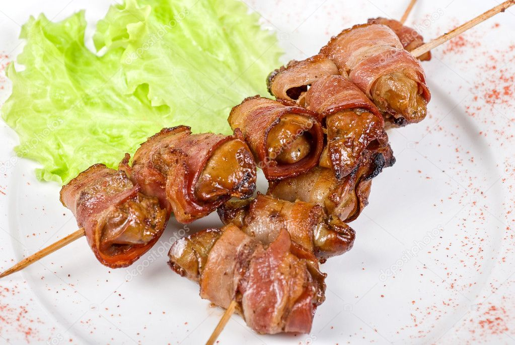 Kebab from chicken liver wrapped with bacon and garlic sauce  Stock Photo #3278929