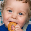 Baby boy with bread ring — Stock Photo
