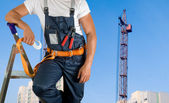 Steeplejack closeup on building background — Stock Photo