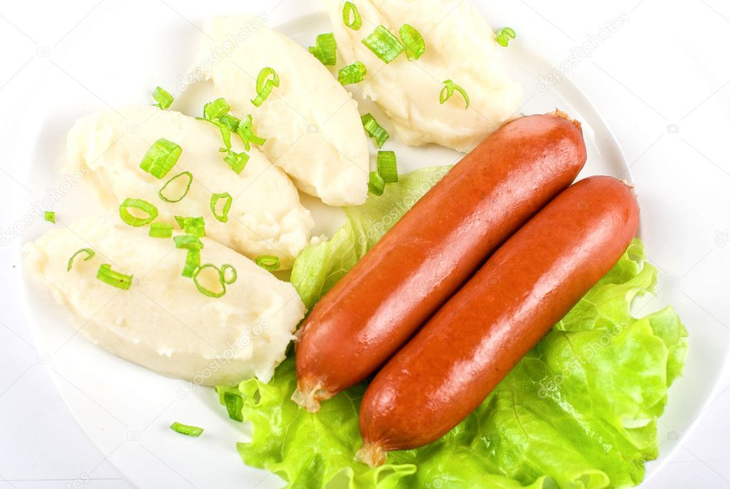 Cutlets from potato and sausage at green lettuce and green onion — Stock Photo #3430658