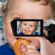 Stockfoto: Baby boy recording to camcorder