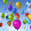 Colored balloons on a blue sky — Stock Photo