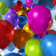 Colored balloons on a blue sky — Stock Photo #3505746