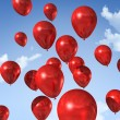 Red balloons on a blue sky — Stock fotografie