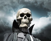 Grim reaper. death's skeleton on a cloudy dramatic sky — Stock Photo