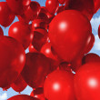 Red balloons on a blue sky — Stock Photo
