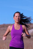 Jogger in Purple Top — Stock Photo