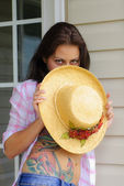 Young Woman holding Hat — Stock Photo