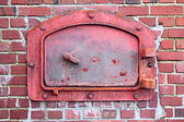Красный сжигания дверь — Стоковое фото