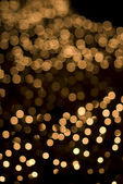 Defocused yellow light dots — Stock Photo